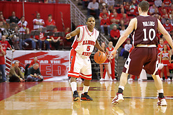"05 January 2008:  Keith ""Boo"" Richardson slows down the attack to try and throw off Bryan Mullins. The Redbirds of Illinois State took the bite out of the Salukis of Southern Illinois winning the Conference home opener for the 'birds on Doug Collins Court in Redbird Arena in Normal Illinois by a score of 56-47."