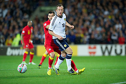 CARDIFF, WALES - Friday, October 12, 2012: Scotland's Charlie Adam in action against Wales during the Brazil 2014 FIFA World Cup Qualifying Group A match at the Cardiff City Stadium. (Pic by David Rawcliffe/Propaganda)