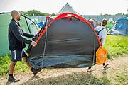 Bringing in a ready made tent - The 2019 Glastonbury Festival, Worthy Farm. Glastonbury.