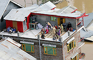 FLOODING IN JAMMU &amp; KASHMIR<br /> Stranded residentsawait rescue from the tops of their house_11/9/2014<br /> Mandatory Credit Photos: NEWSPIX INTERNATIONAL<br /> <br /> **ALL FEES PAYABLE TO: &quot;NEWSPIX INTERNATIONAL&quot;**<br /> <br /> PHOTO CREDIT MANDATORY!!: NEWSPIX INTERNATIONAL(Failure to credit will incur a surcharge of 100% of reproduction fees)<br /> <br /> IMMEDIATE CONFIRMATION OF USAGE REQUIRED:<br /> Newspix International, 31 Chinnery Hill, Bishop's Stortford, ENGLAND CM23 3PS<br /> Tel:+441279 324672  ; Fax: +441279656877<br /> Mobile:  0777568 1153<br /> e-mail: info@newspixinternational.co.uk
