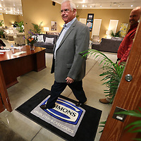 Adam Robison | BUY AT PHOTOS.DJOURNAL.COM<br /> Alan Lewis, a buyer from, West Helena Arkansas, walks out of the new showroom space at United Furniture at the Tupelo Furniture Market Thursday afternoon in Tupelo.