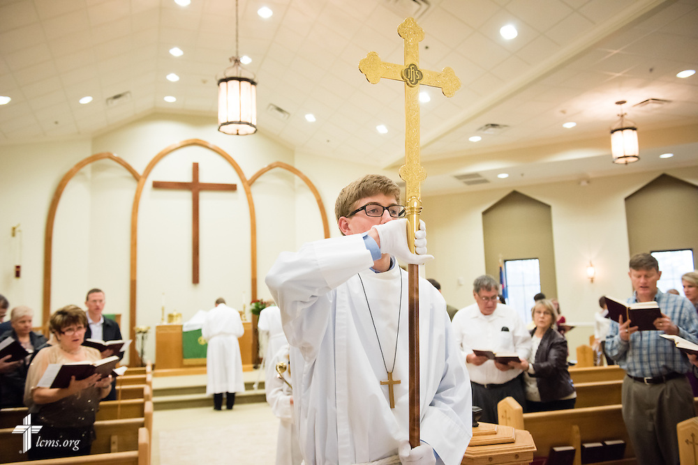 Grant Frerking carries the processional cross during Divine Service on Sunday, Nov. 23, 2014, at Living Faith Lutheran Church in Cumming, Ga. LCMS Communications/Erik M. Lunsford