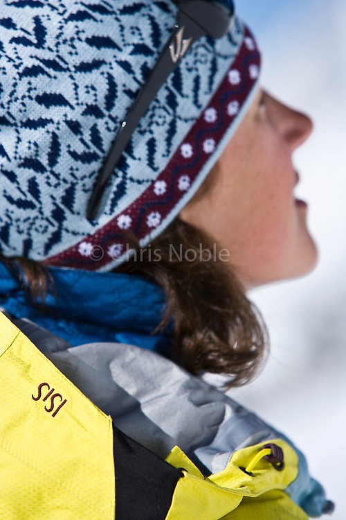 A closeup photograph showing product detail on a woman ski touring in the Wasatch Mountains near Alta, Utah.