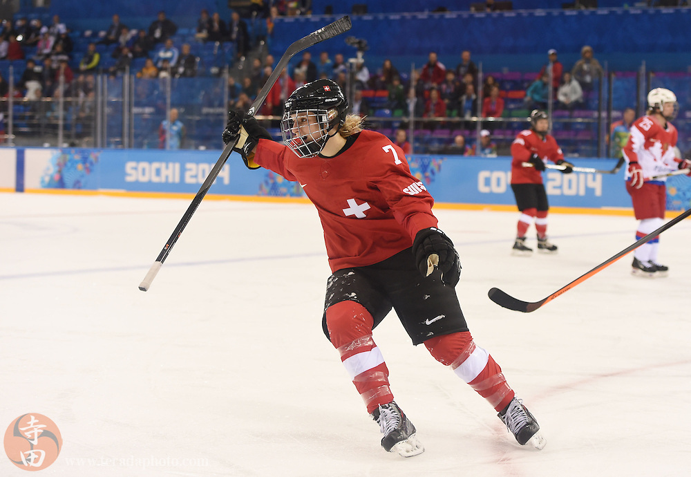 Feb 15, 2014; Sochi, RUSSIA; Switzerland defenseman Lara Stalder (7) celebrates after scoring an empty net goal in a women's quarterfinals ice hockey game during the Sochi 2014 Olympic Winter Games at Shayba Arena.