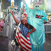 NEW YORK , US - August 19, 2015: three people dressing in Statue of Liberty costumes,Times Square, Midtown of Manhattan