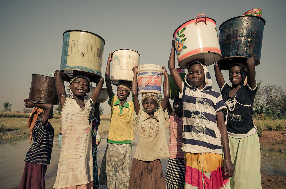These girls are unable to attend school, as they have to help with the household chores; fetching wter in the morning.