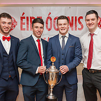 Aidan McGrath,Paddy O'Malley, Conor Brennan and Keane Darcy, members of the Éire Óg U21A Football Team receiving their medals on the night