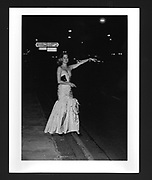 Camilla Wigram hailing a taxi after leaving a Ball given by the Duke of Wellington at Apsley House. 9 July 1985