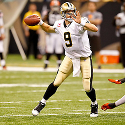Oct 24, 2010; New Orleans, LA, USA; New Orleans Saints quarterback Drew Brees (9) is pressured by Cleveland Browns linebacker David Bowens (96) during the second half at the Louisiana Superdome. The Browns defeated the Saints 30-17.  Mandatory Credit: Derick E. Hingle