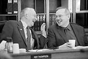 Rep. Steve Thompson (R), left, chats with Rep. Bryce Edgmon (D) before the morning House Finance Committee meeting.