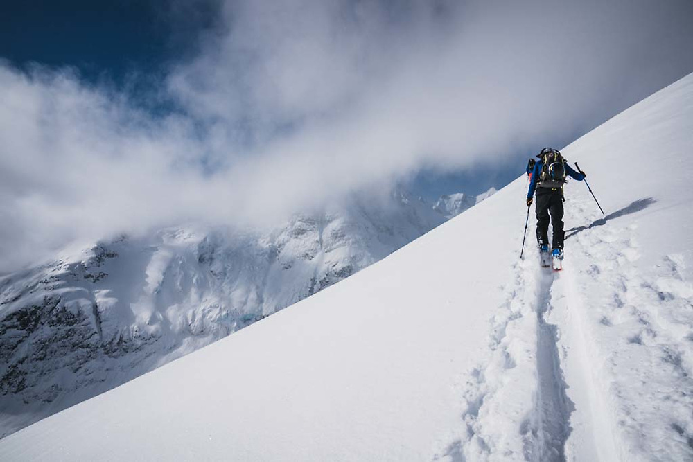 Simon Thomson on his way up to Solitaire Ski Peak, Howson Range, British Columbia.