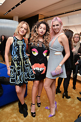 Left to right, TESS WARD, ELLA EYRE and AMBER LE BON at the launch of the new Giusepe Zanotti store in Conduit Street, London on 26th October 2016.