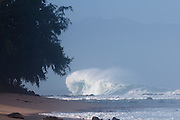 A huge North Shore wave pummels the shore.