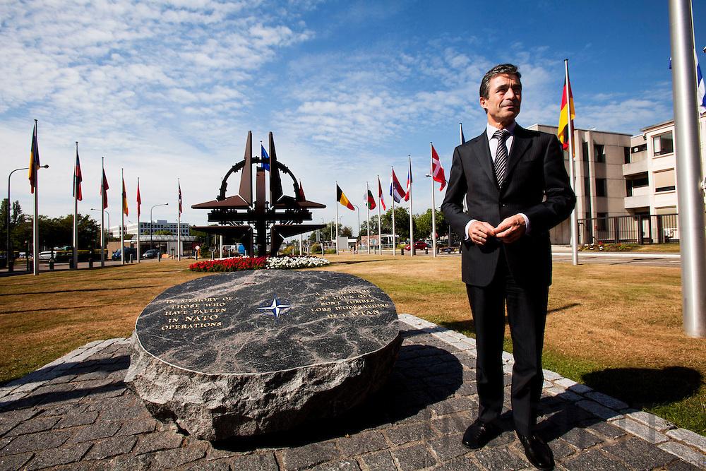 Udvalgsfotos til RITZAU historie der sendes ud den fredag den 6 august Kl. 8.00 -- BRUSSELS - BELGIUM - 07 JULY 2010 -- Interview med Anders Fogh Rasmussen, Nato's Generalsekretær, som her staar ved mindesmaerket for Nato's faldne soldater. Sten er fra Bornholm og blev doneret af Danmark. PHOTO: ERIK LUNTANG / INSPIRIT Photo