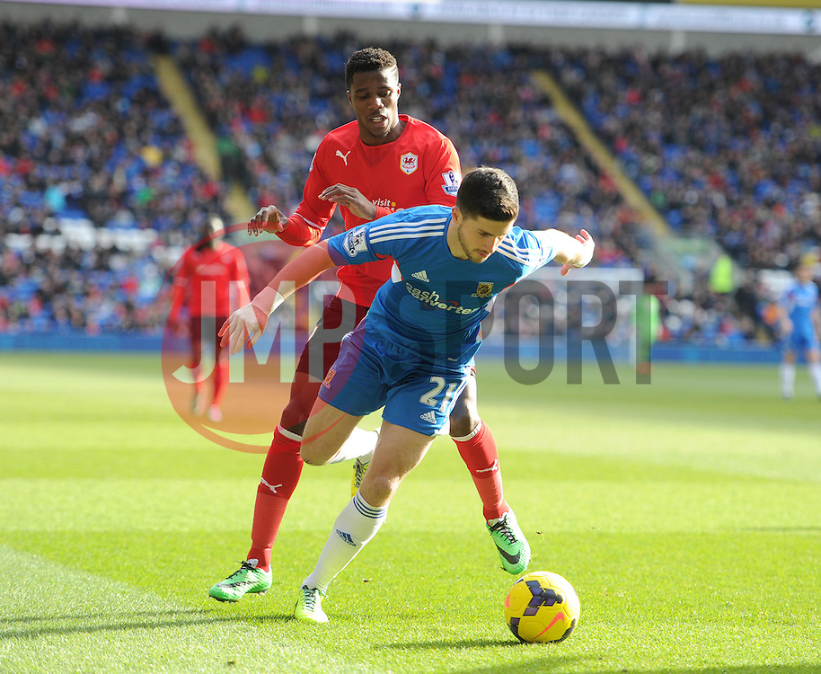 Hull City's Shane Long  shields the ball from Cardiff City's Wilfred Zaha - Photo mandatory by-line: Alex James/JMP - Tel: Mobile: 07966 386802 22/02/2014 - SPORT - FOOTBALL - Cardiff - Cardiff City Stadium - Cardiff City v Hull City - Barclays Premier League