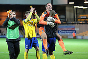Maidenhead United goalkeeper Carl Pentney celebrates with team mates after their result in The FA Cup match between Port Vale and Maidenhead United at Vale Park, Burslem, England on 8 November 2015. Photo by Jemma Phillips.