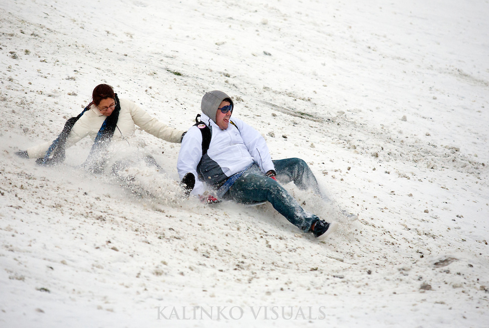 """01192012- Seattleites sled down the hill at Gasworks Park during day two of Seattle's """"Snowmageddon."""""""