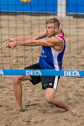 Steven van de Velde in action. The DELA NK Beach volleyball for men and women will be played in The Hague Beach Stadium on the beach of Scheveningen on 22 July 2020 in Zaandam.