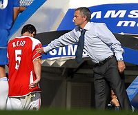 Photo: Ed Godden.<br />Chelsea v Charlton Athletic. The Barclays Premiership. 09/09/2006. Charlton's Andy Reid (L) is tapped on the arm by Chelsea Manager, Jose Mourinho, after he walks off the pitch injured.