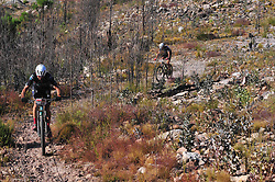 WELLINGTON SOUTH AFRICA - MARCH 22: Nico Bell and Matt Beers during stage three's 111km from Wellington to Worcester on March 22, 2018 in Western Cape, South Africa. Mountain bikers gather from around the world to compete in the 2018 ABSA Cape Epic, racing 8 days and 658km across the Western Cape with an accumulated 13 530m of climbing ascent, often referred to as the 'untamed race' the Cape Epic is said to be the toughest mountain bike event in the world. (Photo by Dino Lloyd)