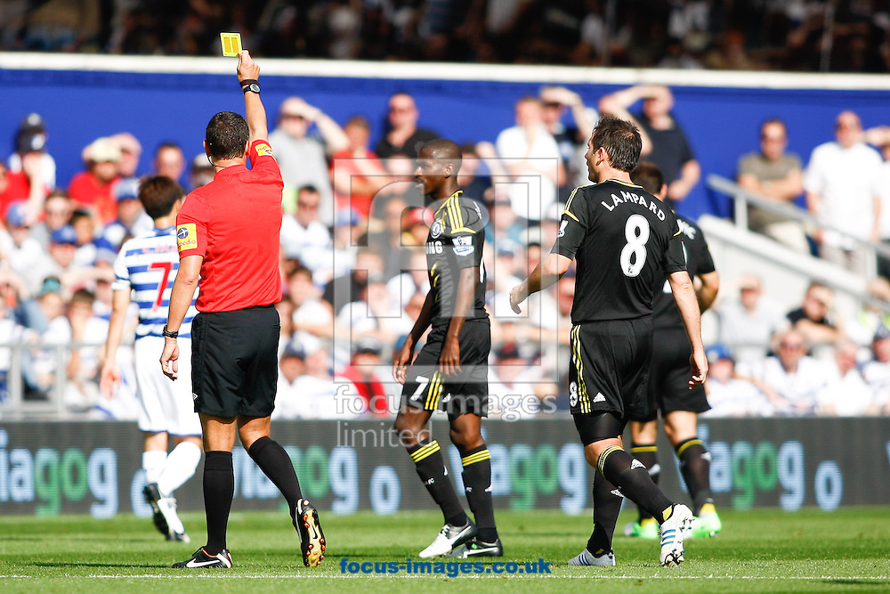 Picture by Andrew Tobin/Focus Images Ltd +44 7710 761829.15/09/2012.Ramires of Chelsea is shown a yellow card by referee Mr A Marriner during the Barclays Premier League match at the Loftus Road Stadium, London.