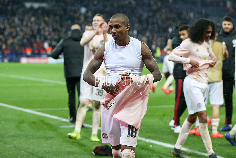 Manchester United Midfielder Ashley Young celebrates with shirt off during the Champions League Round of 16 2nd leg match between Paris Saint-Germain and Manchester United at Parc des Princes, Paris, France on 6 March 2019.