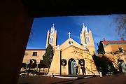 SHOT 12/26/2007 - San Felipe de Neri Church is a historic Catholic church located on the north side of Old Town Plaza in Albuquerque, New Mexico. Built in 1793, it is the oldest surviving building in the city of Albuquerque. The original building was completed in 1719. The original church building collapsed in 1792 after a heavy rain and was replaced by the current structure the following year. The towers were added in 1861, a parish school was constructed in 1878, and a convent for the Sisters of Charity was built on the west side of the church in 1881. Today the church complex is undergoing extensive renovations inside and out. Albuquerque is the largest city in the state of New Mexico, United States. It is the county seat of Bernalillo County and is situated in the central part of the state, straddling the Rio Grande. The city population was 448,607 as of the 2000 U.S. census. As of the 2006 census estimate, the city's population was 504,949, with a metropolitan population of 816,811 as of July 1, 2006. In 2006, Albuquerque ranked as the 33rd-largest city and 61st-largest metropolitan area in the U.S. Albuquerque is home to the University of New Mexico (UNM) and Kirtland Air Force Base as well as Sandia National Laboratories and Petroglyph National Monument. The Sandia Mountains run along the eastern side of Albuquerque and the Rio Grande flows through the city north to south..(Photo by Marc Piscotty/ © 2007)