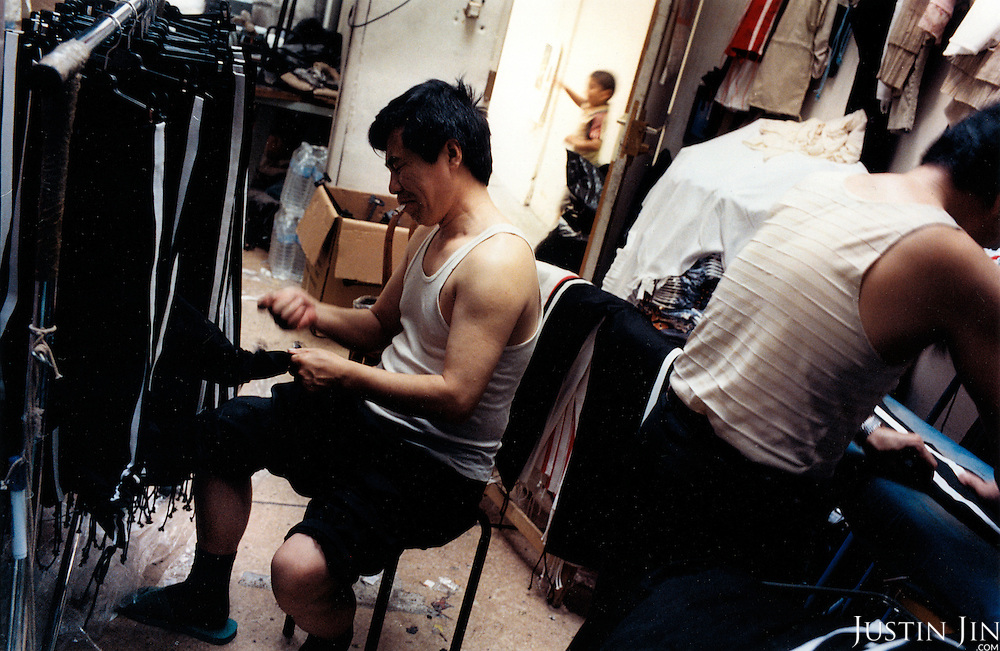 France, Paris, 05-2003..Illegal Chinese at a garment sweat-shop in Paris. They are a new wave of immigrants from China?s northeast, home to millions of former cradle-to-grave factory workers laid off by closures. ..