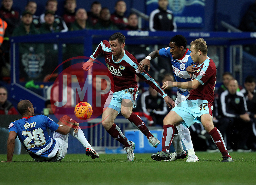 Karl Henry of Queens Park Rangers tries to control the ball as David Jones of Burnley tries to win the ball - Mandatory byline: Robbie Stephenson/JMP - 12/12/2015 - Football - Loftus Road - London, England - Queens Park Rangers v Burnley  - Sky Bet Championship