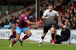 Marcus Maddison of Peterborough United takes on Jordan Clarke of Scunthorpe United - Mandatory by-line: Joe Dent/JMP - 21/10/2017 - FOOTBALL - Glanford Park - Scunthorpe, England - Scunthorpe United v Peterborough United - Sky Bet League One