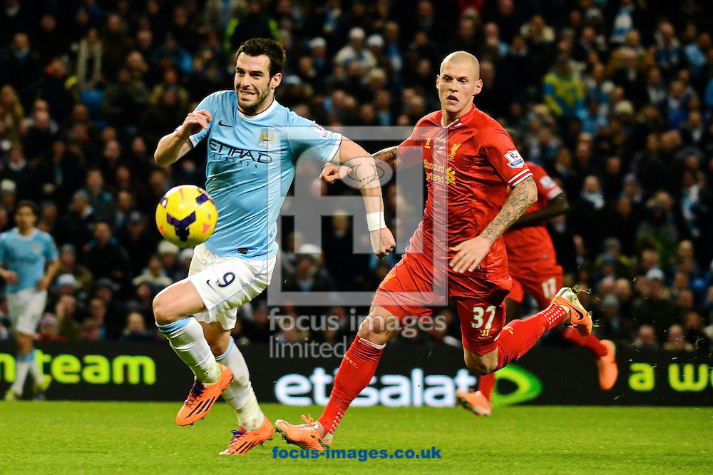 Picture by Ian Wadkins/Focus Images Ltd +44 7877 568959<br /> 26/12/2013<br /> &Aacute;lvaro Negredo of Manchester City is pursued by Martin &Scaron;krteľ of Liverpool during the Barclays Premier League match at the Etihad Stadium, Manchester.