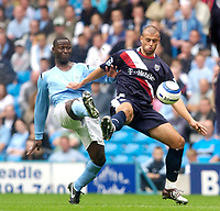 Photo: Daniel Hambury.<br /> Manchester City v West Bromich Albion. Barclaycard Premiership. 13/08/2005.<br /> Manchester City's Andrew Cole and West Brom's Neil Clement battle for the ball.