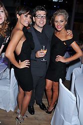 Left to right, FRANKIE SANDFORD, MICHAEL MCINTYRE and MOLLIE KING at the GQ Men of the Year 2011 Awards dinner held at The Royal Opera House, Covent Garden, London on 6th September 2011.