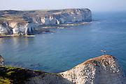Coastal scenery at Flamborough Head, Yorkshire, England. Man standing on steep headland.