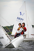 Two Junior Olympics sailors flatten the boat heading upwind during the 2011 Midwest championships at Wayzata Yacht club on Sunday.