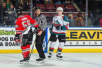KELOWNA, CANADA - MARCH 2:  Schael Higson #21 of the Kelowna Rockets gets in the face of Clay Hanus #58 of the Portland Winterhawks as he is escorted to the penalty box on March 2, 2019 at Prospera Place in Kelowna, British Columbia, Canada.  (Photo by Marissa Baecker/Shoot the Breeze)