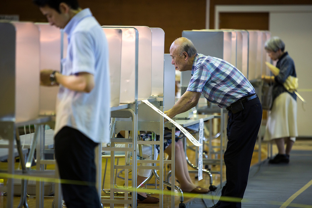 TOKYO, JAPAN - JULY 10 : A man select his candidate to vote for parliament's upper house election at a polling station in Tokyo, Japan on Sunday, July 10, 2016. The revised law has expanded the electorate by 2.4 million people aged 18 and 19, and is designed to give more political say to younger generations. The first Upper house election nation-wide in Japan that 18 years old can vote after government law changes its voting age from 20 years old to 18 years old. (Photo by Richard Atrero de Guzman/NUR Photo)