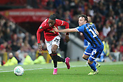 Manchester United's Aaron Wan-Bissaka gets away from Rochdale's Oliver Rathbone during the EFL Cup match between Manchester United and Rochdale at Old Trafford, Manchester, England on 25 September 2019.