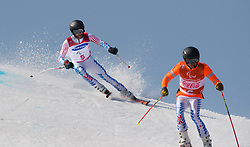 March 14, 2018 - Pyeongchang, South Korea - Kevin Burton of the US follows guide Brandon Ashby during the Giant Slalom competition Wednesday, March 14, 2018 at the Jeongson Alpine Center at the Pyeongchang Winter Paralympic Games. Photo by Mark Reis (Credit Image: © Mark Reis via ZUMA Wire)