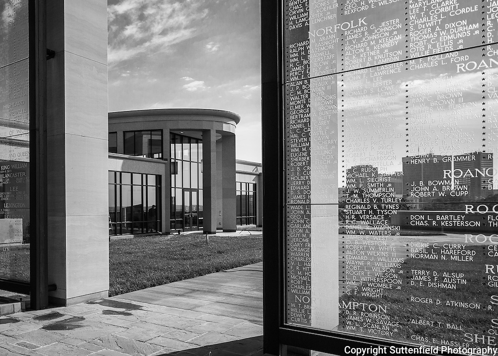 The new Paul and Phyllis Galanti Education Center can be seen reflected in the pool of the original 1955 Virginia War Memorial.<br />