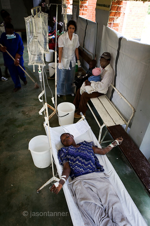 34 year old Kumbini Brand is given intravenous fluids at the screening and admission section of a Cholera Treatment Centre in Harare...Children and adults are treated at Beatrice Road Infectious Diseases Clinic in Harare, Zimbabwe...The clinic is staffed by locals but assisted by MSF.