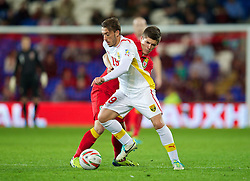 11.10.2013, City Stadion, Cardiff, WAL, FIFA WM Qualifikation, Wales vs Mazedonien, Gruppe A, im Bild Wales' Declan John in action against Macedonia's Agim Ibraimi during the FIFA World Cup Qualifier Group A Match between Wales and Macedonia at the City Stadium, Cardiff, Wales on 2013/10/11. EXPA Pictures © 2013, PhotoCredit: EXPA/ Propagandaphoto/ David Rawcliffe<br /> <br /> ***** ATTENTION - OUT OF ENG, GBR, UK *****