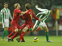 Photo: Aidan Ellis.<br /> Liverpool v Real Betis. UEFA Champions League.<br /> 23/11/2005.<br /> Liverpool's Dietmar Hamann and Boudejwin Zenden get in each others way as they challenge Betis Melli
