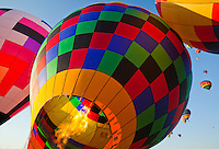 Setting up hot air balloons at the Albuquerque, New Mexico Balloon Fiesta, USA.