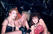 Two girls dressed in lingerie with a topless New Romantic male.  Helen, Mandy and Barclay at Dave Darlings Club, Bristol 1985