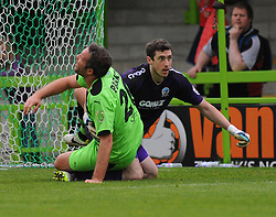 Forest Green Rovers's Jonathan Parkin collides with Dover Athletic's Andy Rafferty - Photo mandatory by-line: Nizaam Jones - Mobile: 07966 386802 - 25/04/2015 - SPORT - Football - Nailsworth - The New Lawn - Forest Green Rovers v Dover - Vanarama Conference League