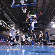 Reno Bighorns Guard Tajuan Porter (12) drives towards the basket as Delaware 87ers Forward Victor Rudd (23) defends in the first half of a NBA D-league regular season basketball game between the Delaware 87ers and the Reno Bighorns (Sacramento Kings), Tuesday, Feb. 10, 2015 at The Bob Carpenter Sports Convocation Center in Newark, DEL