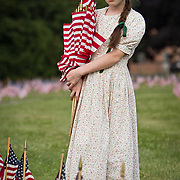 Erica Neemeyer, 11, planted flags with her family at the Soldiers National Cemetery, during the Sesquicentennial Anniversary of the Battle of Gettysburg, Pennsylvania on Sunday, June 30, 2013.  A pivotal battle in the Civil War, over 50,000 soldiers died in the battle which spanned 3 days from July 1-3, 1863.  Later that year, President Abraham Lincoln returned to Gettysburg to deliver his now famous Gettysburg Address to dedicate the cemetery there for the Union soldiers who died in battle.  John Boal photography