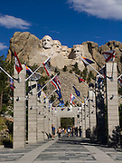 4 presidents chiseled in granite by Gutzon Borglum seen from Avenue of Flags
