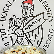 A plate with Baccala Mantecato is seen in front of the sign of the brotherhood of the Baccala stands of the Biennale del Gusto on October 28, 2013 in Venice, Italy. The Biennale del Gusto is an exhibition held over four days, dedicated to traditional food and drinks from all regions of Italy.